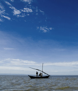 Fishermen  on Kenya's Lake Victoria supply Kennedy's fish mongering business.